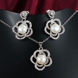 PARURE Parure avec une perle