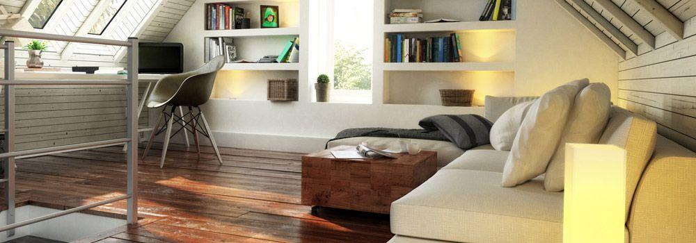canapé beige, étagères avec des livres