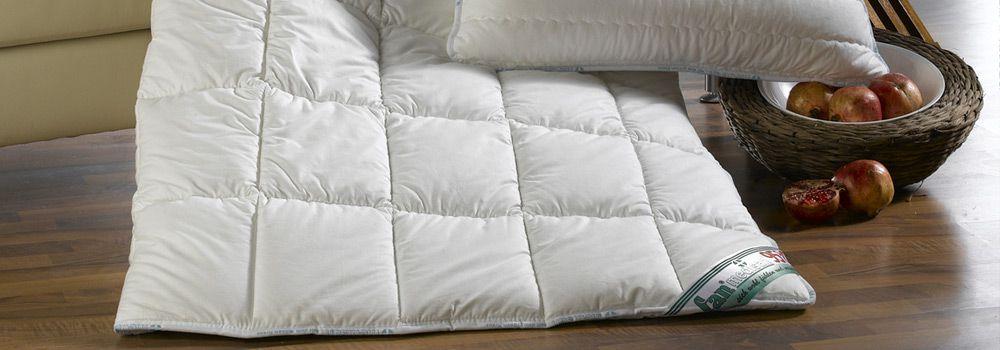 comment choisir une couette. Black Bedroom Furniture Sets. Home Design Ideas