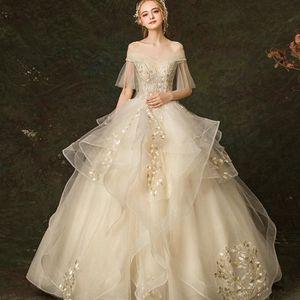 be42ac672fa54 ROBE DE MARIÉE À Manches courtes Lumière Champagne Robes de Maria