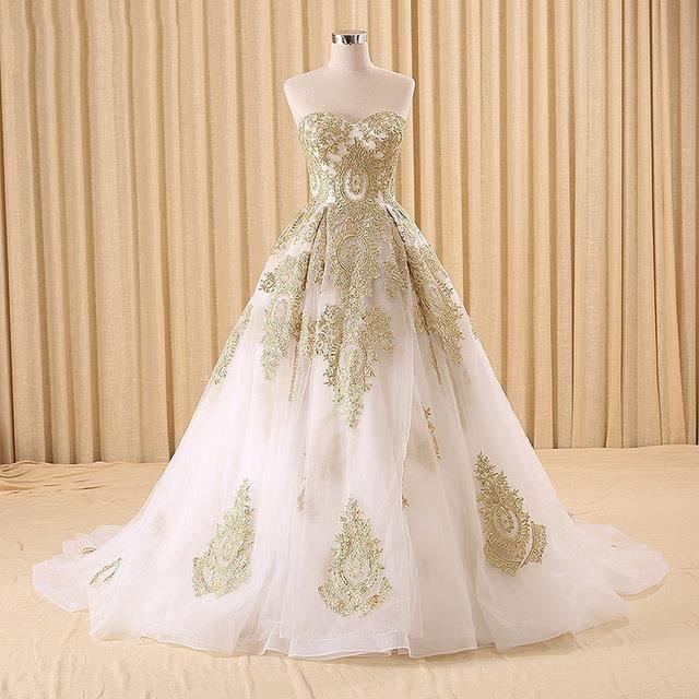 a4c1f3c313f Robe de soirée robe de cérémonie or magnifique forme princesse applique  broderie pailleté