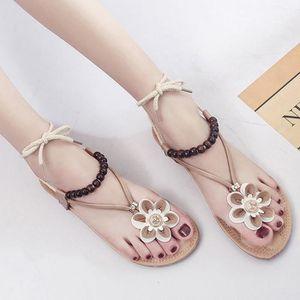 nouveau concept 971a1 ea5c8 Sandales Bohême Fleurs de femmes à lacets Sandales plates perles bretelles  Chaussures de plage marron ZHQ90401354BW marron