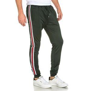 PANTALON Pantalon de jogging vert luisant avec bandes color f02a7807f33