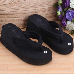 CHAUSSON - PANTOUFLE Les pantoufles noir Talon muffin pantoufles servie