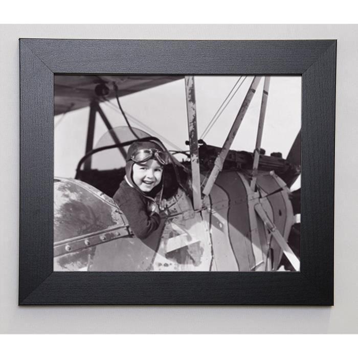EVERETT COLLECTION Image encadrée Little boy in cockpit 31x37 cm Gris