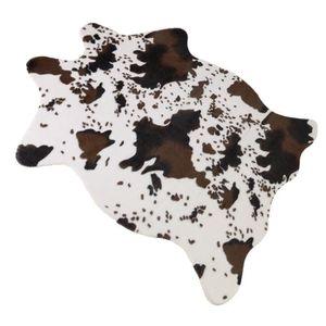 tapis peau de vache achat vente pas cher. Black Bedroom Furniture Sets. Home Design Ideas