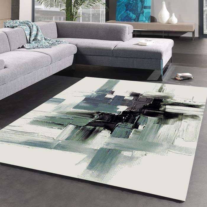 Matière : 100% polypropylène - Dimensions : 120x170 cm - Densité : 3000gr/m² - Coloris : gris et bleuTAPIS - DESSOUS DE TAPIS